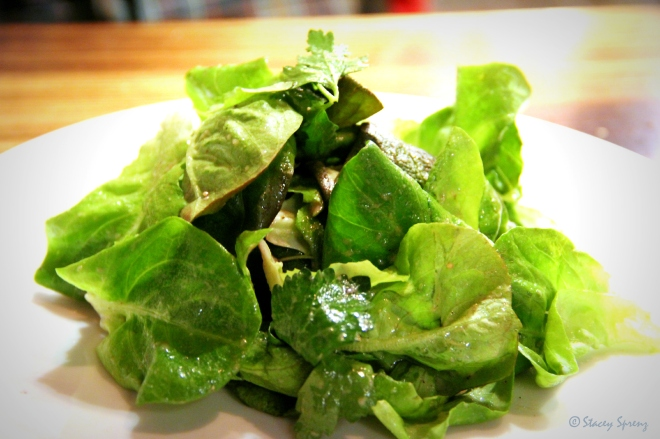 Mixed greens salad with herbs.