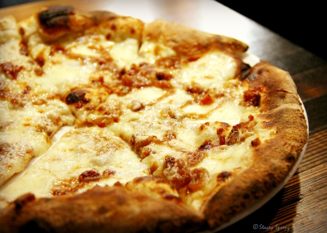 White Pizza with béchamel, smoked mozzarella, caramelized onions, and bacon.  A gift from heaven--I am sure of it.