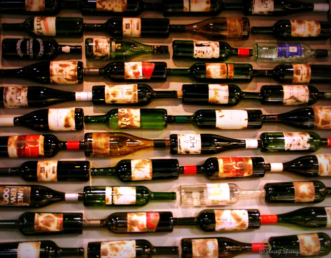 Reduce, reuse, recycle by decorating with wine bottles!