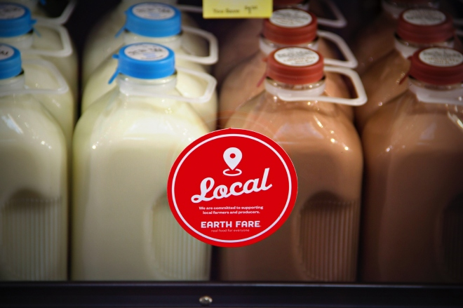 This sign denotes items that are sourced locally.  Mapleview Farms milk is in the dairy case at Earth Fare.