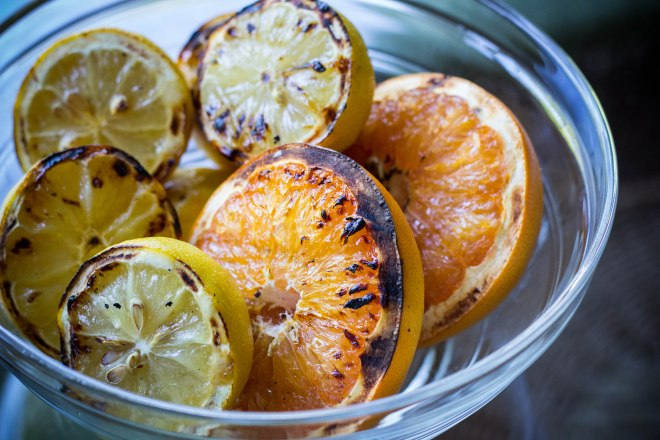 Grilling your citrus gives a wonderful flavor to cocktails.  Simply place cut side down on medium heat for about 5 minutes or until softened.